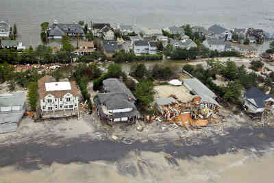 homes damaged after Hurrican Sandy - liability questions still loom
